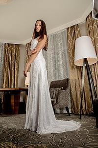 woman wearing white spaghetti-strap dress