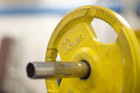 33 LBS yellow round dumbbell