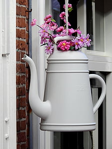 pink flowers on white watering can