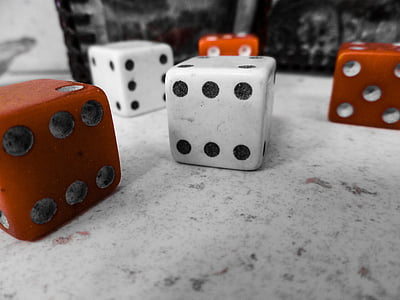 red and white dices on top of white surface