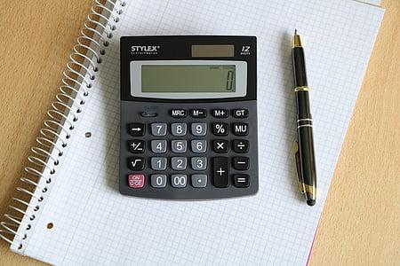 black Stylex calculator beside black twist pen