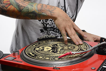 person spinning turntable
