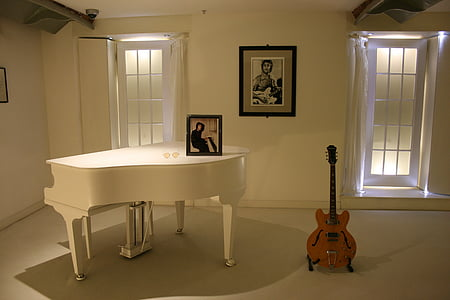 guitar beside the grand piano