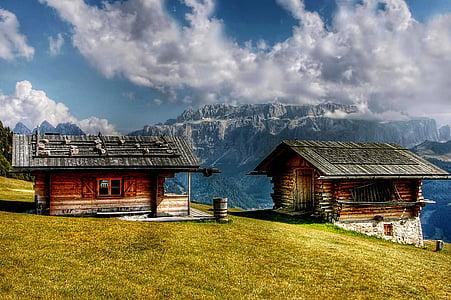 brown nipa huts on mountain