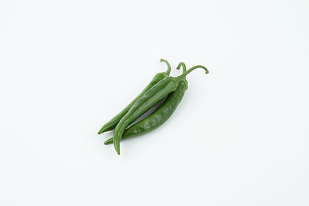 three green chili peppers