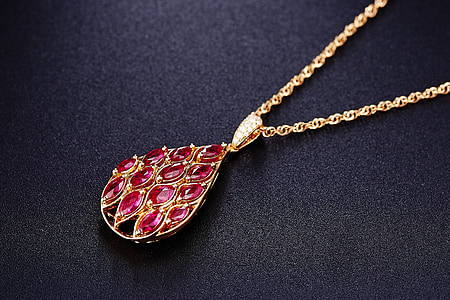 red jeweled gold-colored pendant necklace