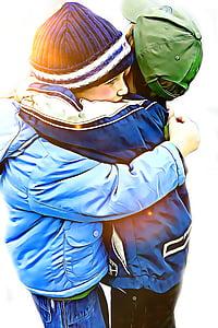 two boy's hugging each other