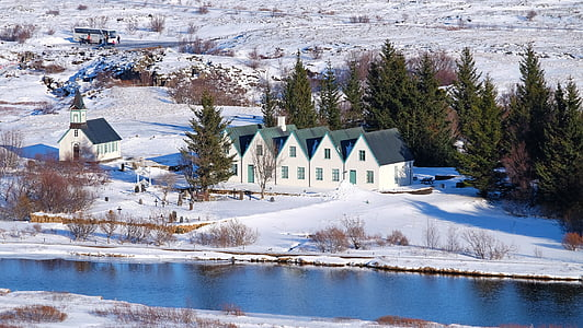 five white houses near a river in snow terrain