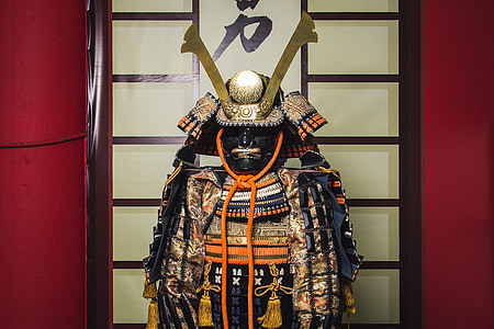 Samurai armor decor near beige wall