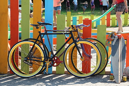 two bicycles parked beside fence