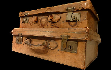two pilling brown leather suitcases