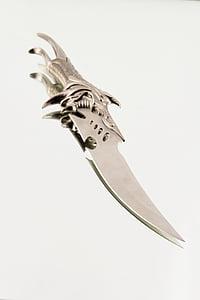 silver-colored dagger