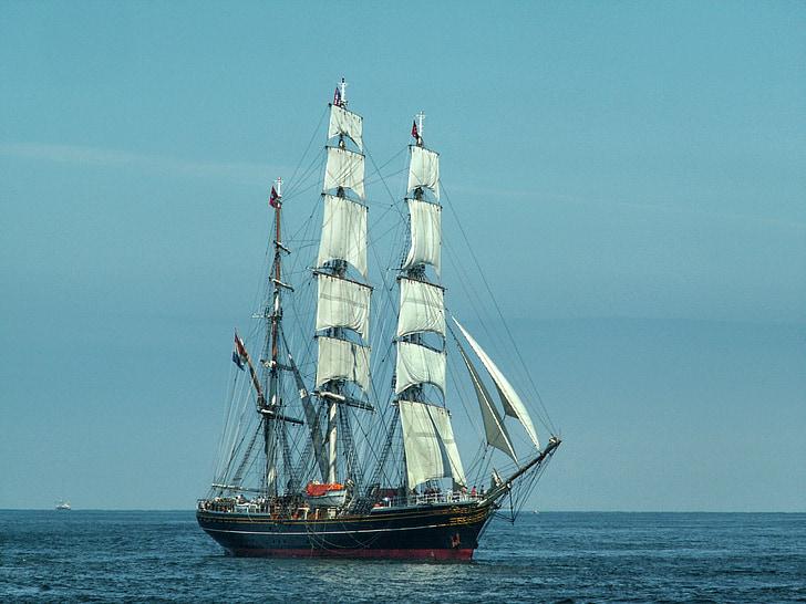 white and black sailing ship on sea