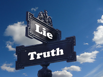 black and white lie and truth signage during daytime