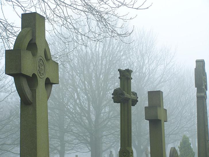 cemetery cross in mist