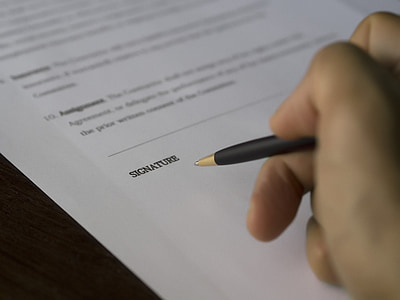 pen pointing on signature sheet