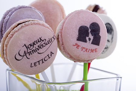closeup photo of French macaroons on stick