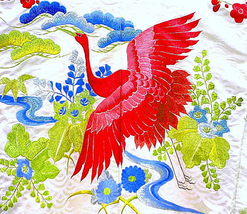 red bird with blue and green flower textile