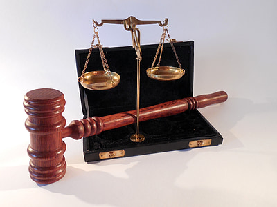 gold justice scale and brown wooden mallet