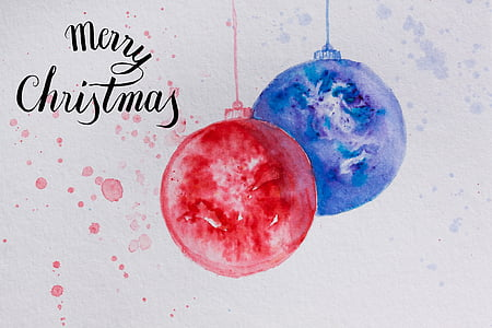 red and blue bauble with merry christmas text overlay
