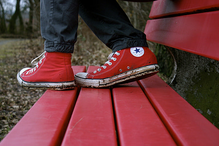 person wearing red Converse All-Star High-Tops