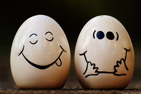 selective focus photography of two ceramic egg figurines