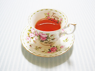 white and pink floral tea cup set