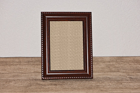 brown photo frame on brown surface