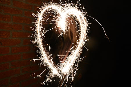 yellow sparks forming heart