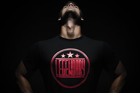 man in black and red Legendary-printed crew-neck shirt