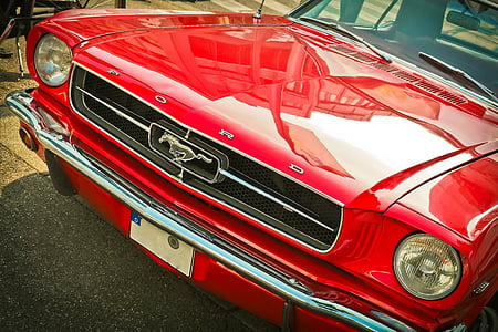 selective focus photo of red Ford Mustang coupe