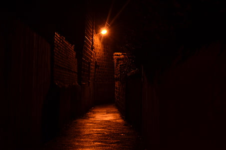 photo of gray concrete pathway with turned on light at nighttime