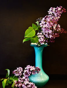 pink petaled flowers on green glass vase