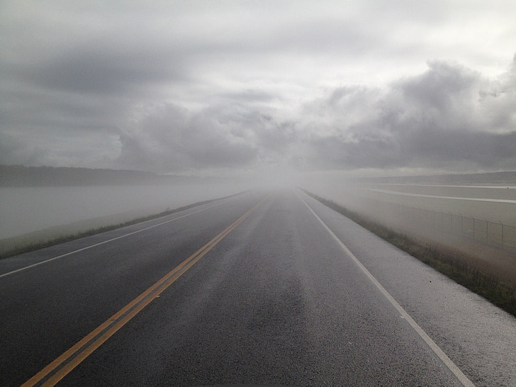 gray empty asphalt road covered with fogs