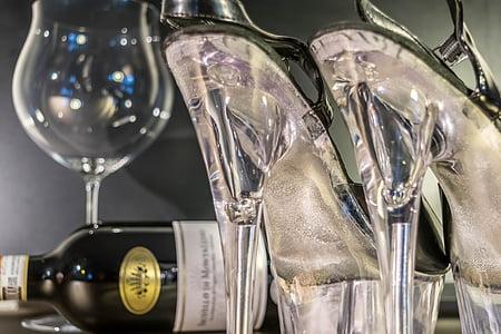 wine bottle and clear stilettos