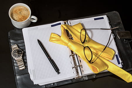 eyeglasses on white graphing notebook