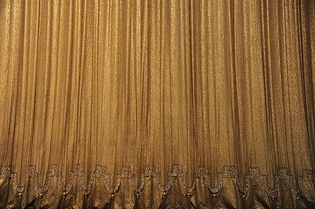 closeup photo of brown curtain