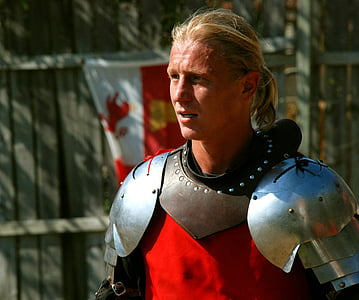 shallow focus photography of man wearing silver armor