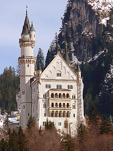 white and beige castle near mountain