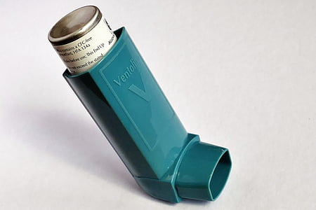 green Ventoline asthma inhaler