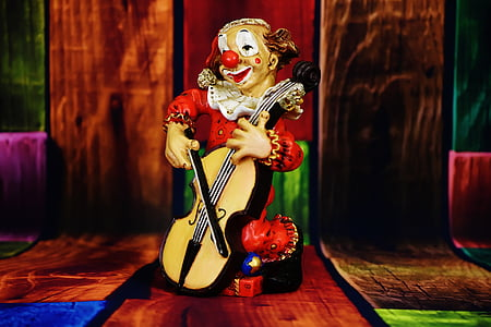 clown playing cello figurine