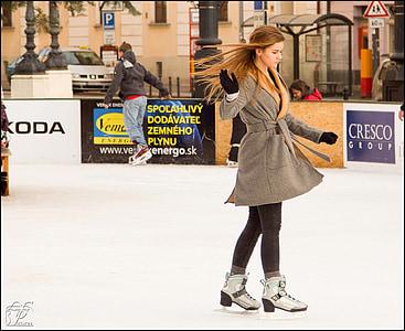 woman skating wearing brown coat