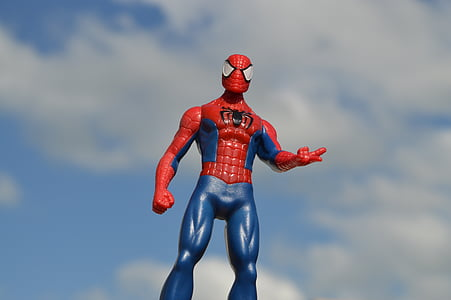 Spider-Man action figure under blue and white cloudy sky