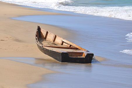 brown jon boat on sea shore