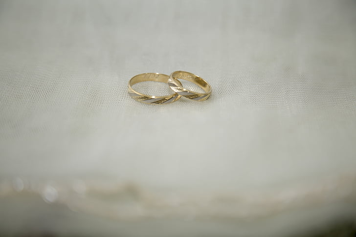 close up photography of two gold-colored rings