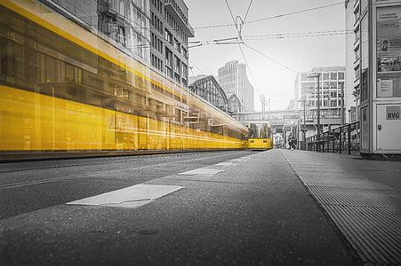 yellow bus near building