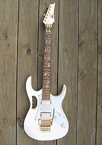 white and gray electric guitar