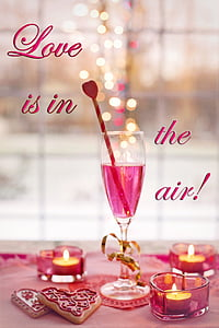 clear wine glass with Love is in the air! text overlay