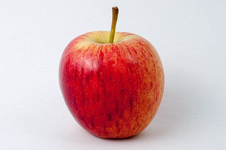 macro photography of red apple