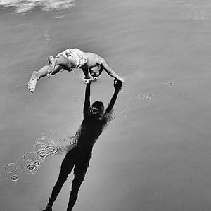 grayscale photography of person diving on water